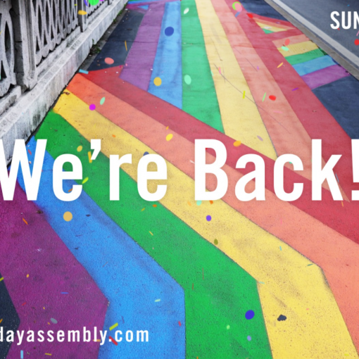 A rainbow coloured road with the event title We're Back superimposed