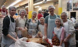 Sunday Assembly Portland helping often at a Food Bank